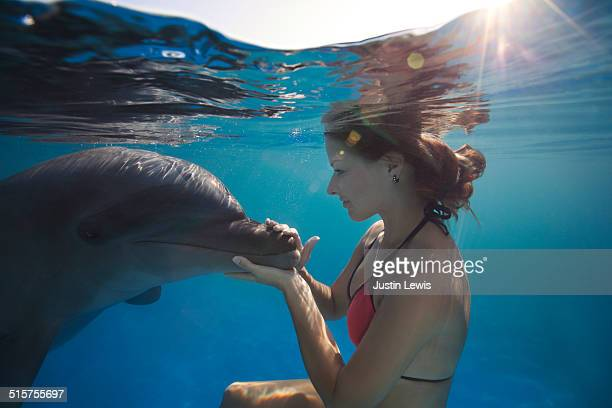 Underwater Young Woman With Dolphin Closeup