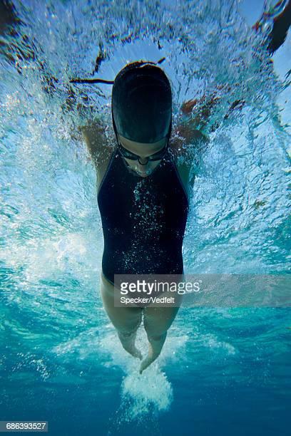 Underwatershot of swimmer diving