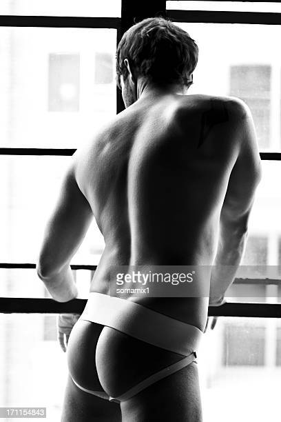 Underwear model looking out window - Black and White