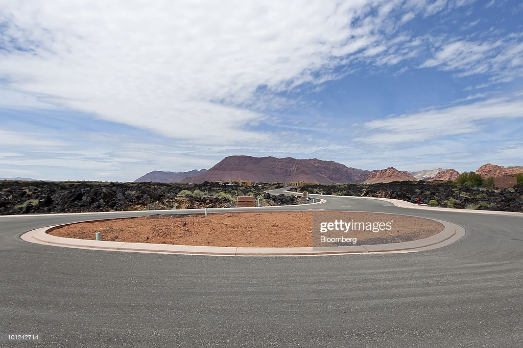 Undeveloped housing lots for new homes surround a cul-de-sac at the Split Rock at Entrada development in St. George, Utah, U.S., on Wednesday, May 26, 2010. Housing starts rose to a 672,000 annual rate last month, the highest since October 2008 and up 5.8 percent from March, Commerce Department figures showed this month. After almost five years of falling sales and prices, homebuilders are looking to see if the nation's fledgling economic recovery can sustain the real estate market as government subsidies end. Photographer: George Frey/Bloomberg via Getty Images