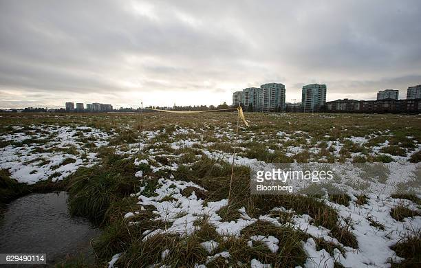 Undeveloped land stands near downtown Richmond British Columbia Canada on Sunday Dec 11 2016 In August the province of British Columbia imposed a 15...