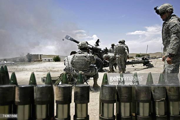 US soldiers from the 4th Batalion Combat Team 2321 Field Artilery 82 Airbourne Division fire their 105 mm Artilery canon at an undisclosed location...