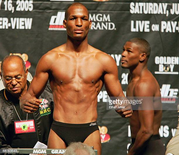 Undisputed middleweight champion boxer Bernard Hopkins of Pennsylvania poses on the scale after he and Jermain Taylor of Arkansas were weighed in at...