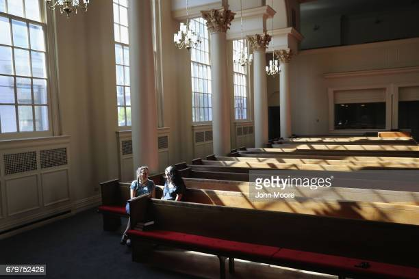 Undocumented immigrant Jeanette Vizguerra speaks with a friend while taking sanctuary at the First Baptist Church on May 5 2017 in Denver Colorado...