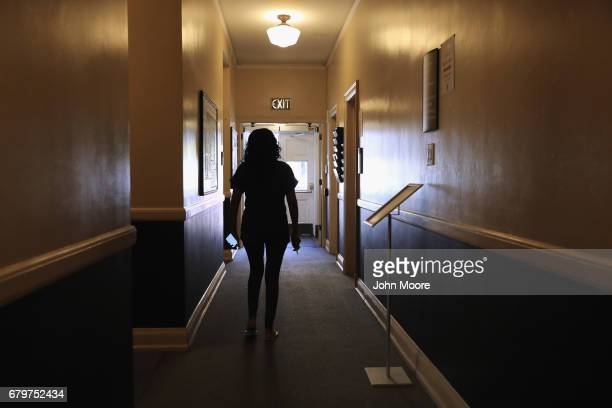 Undocumented immigrant Jeanette Vizguerra walks through a corridor while taking refuge at the First Baptist Church on May 5 2017 in Denver Colorado...