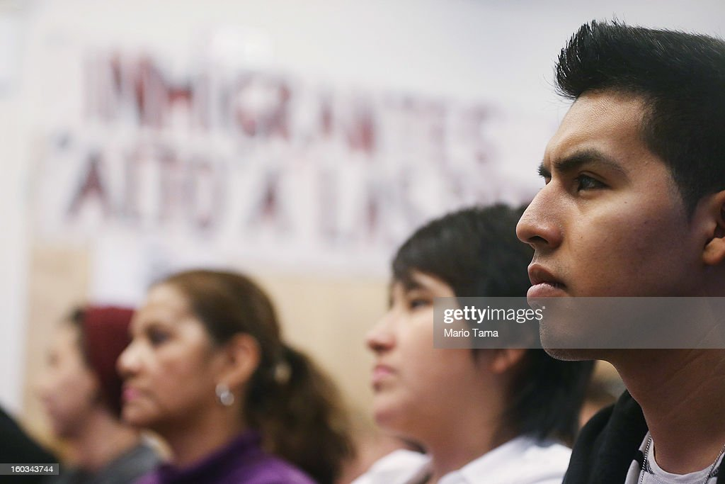 Undocumented immigrant Oscar Rodriguez (R), originally from Mexico, watches during a watch party of U.S. President Barack Obama's speech on immigration on January 29, 2013 in New York City. Obama called for immigration reform and a 'pathway to citizenship' for the nation's 11 million undocumented immigrants.