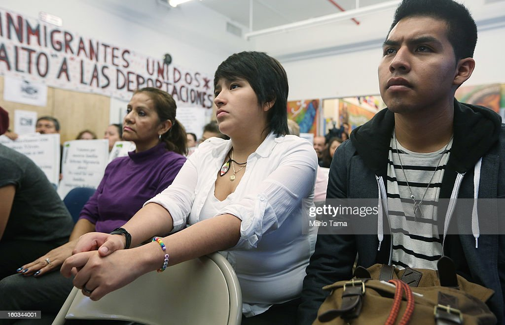 Undocumented immigrant Oscar Rodriguez (R), originally from Mexico, watches with Yenny Quispe (C), who is from Peru and received her Green Card two days ago, during a watch party of President Barack Obama's speech on immigration on January 29, 2013 in New York City. Obama called for immigration reform and a 'pathway to citizenship' for the nation's 11 million undocumented immigrants.