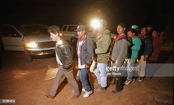 Undocumented immigrants caught trying to illegally enter the US through Douglas Arizona from Agua Prieta Mexico are loaded into Border Patrol...
