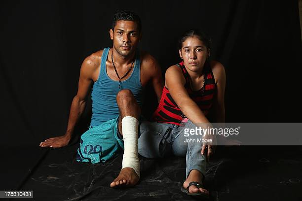 Undocumented immigrants Eduardo Contreras from Honduras and Elvira Lopez from Guatemala sit at the Jesus el Buen Pastor shelter on July 31 2013 in...