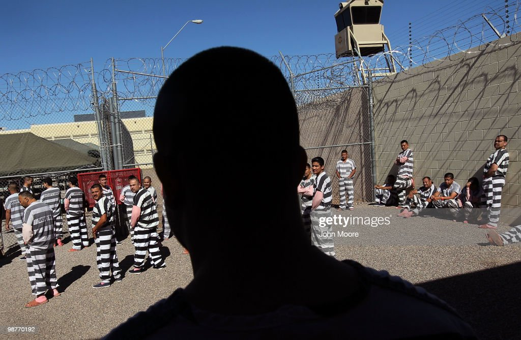 Undocumented immigrants gather in the Maricopa County 'Tent City Jail' on April 30, 2010 in Phoenix, Arizona. Some 200 undocumented immigrants are currently serving time in the facility, and most will be deported to Mexico after serving their sentence. The controversial jail is run by Maricopa County Sheriff Joe Arpaio, who has been an outspoken critic of illegal immigration and a supporter of Arizona's new tough immigration law. Prisoners at the facility are fed twice a day, sleep in non-airconditioned tents and are issued striped prison uniforms and pink undergarments to wear.