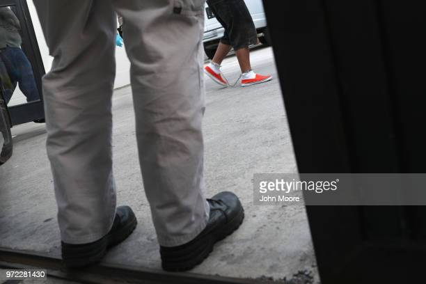 Undocumented immigrants in shackles arrive to a US federal court on June 12 2018 in McAllen Texas Thousands of migrants continue to cross into the US...