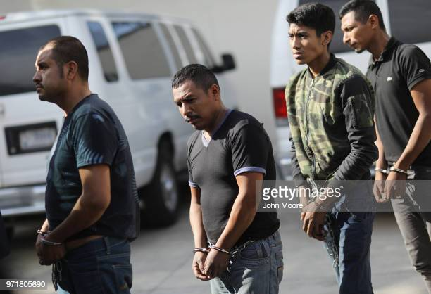 Undocumented immigrants leave a US federal court in shackles on June 11 2018 in McAllen Texas Thousands of migrants continue to cross into the US...