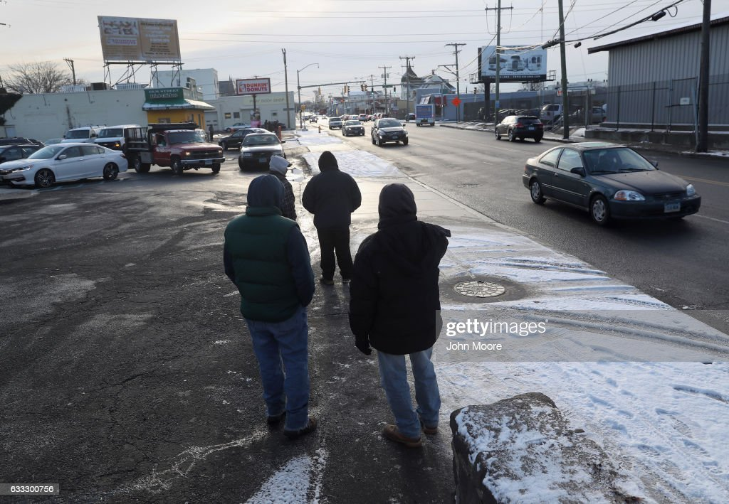 Undocumented immigrants wait for work along a city street on February 1, 2017 in Stamford, Connecticut. The city of Stamford has an official zone for employers to pick up day laborers, although many prefer to stand by nearby businesses for warmth and visibility. Stamford, CT is located in Fairfield County, considered a 'sanctuary county' for not reporting undocumented immigrants to federal authorities.