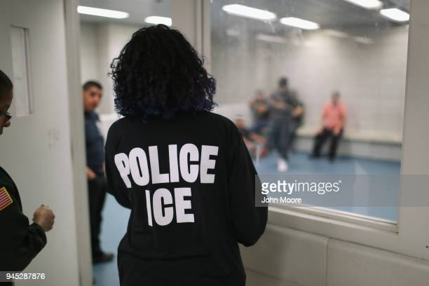 Undocumented immigrants wait in a holding cell at a US Immigration and Customs Enforcement processing center on April 11 2018 at the US Federal...