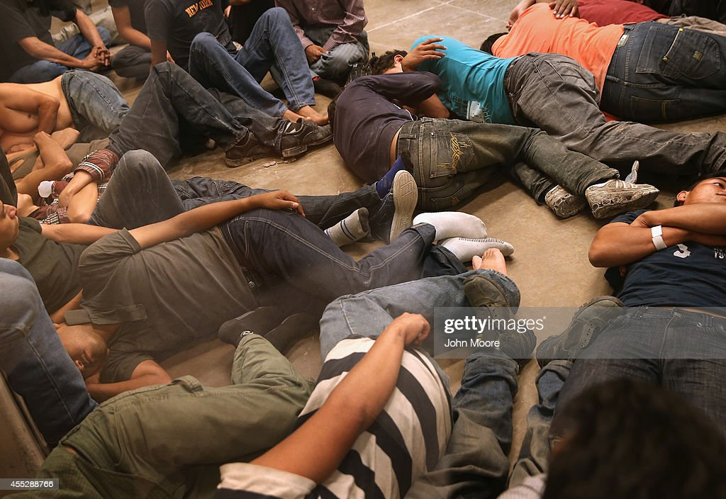 Undocumented immigrants wait in a U S  Border Patrol