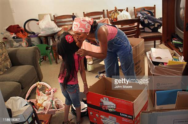 Undocumented Mexican immigrant Jeanette Vizguerra kisses her daughter Luna while packing up belongings in her family apartment on July 11 2011 in...