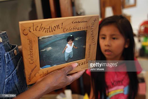 Undocumented Mexican immigrant Jeanette Vizguerra packs up belongings as her daughter Luna looks on in their apartment on July 11 2011 in Aurora...