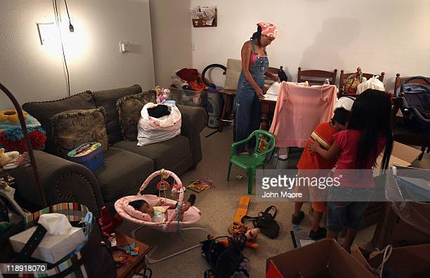 Undocumented Mexican immigrant Jeanette Vizguerra sorts through documents while packing up belongings in her family apartment on July 11 2011 in...