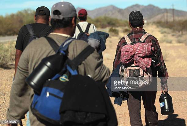 Undocumented Mexican immigrants walk through the Sonoran Desert after illegally crossing the U.S.-Mexico border border on January 19, 2011 into the...