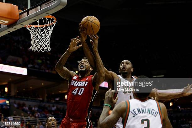 Undonis Haslem of the Miami Heat and Luc Richard Mbah a Moute of the Milwaukee Bucks fight for the rebound during Game Three of the Western...