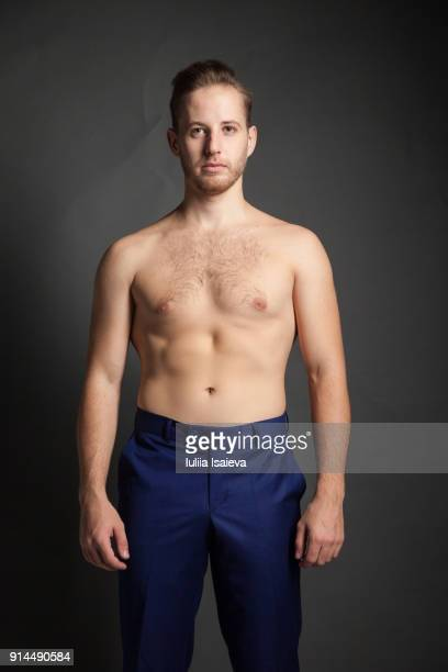 Undressed man in blue pants