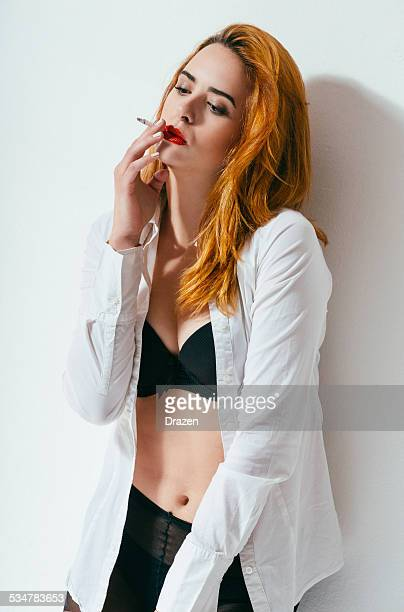 undressing white shirt, showing bra and sttockings and smoking - hot babes stock pictures, royalty-free photos & images