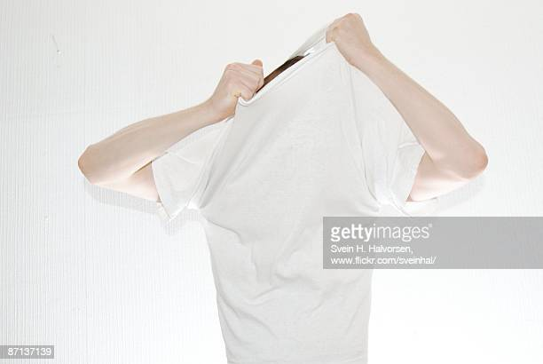 Undressing white t-shirt