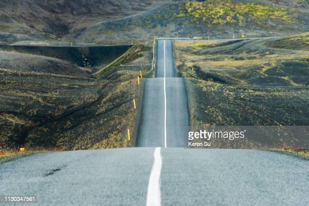 undulating road, south iceland - bumpy stock pictures, royalty-free photos & images