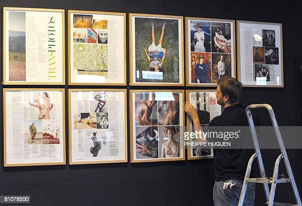 TRANSPHOTOGRAPHIQUES DE LILLE LA MODE ET KARL LAGERFELD A L'HONNEUR Une personne accroche des reproductions de photographies le 14 mai 2008 au Tri...