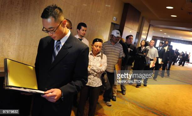 Unemployed Americans line up as they wait to gain entry to meet prospective employers at the Los Angeles Career Fair on March 23 2010 US Treasury...