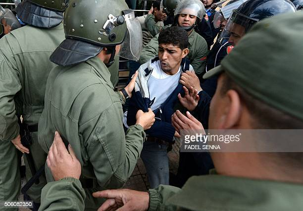 Unemployed and visually impaired Moroccan graduates scuffle with security forces as they try to enter the ministry of Solidarity Women Family and...
