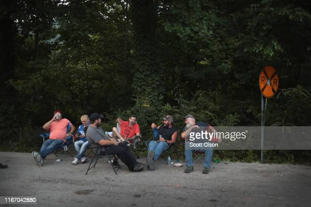 Unemployed Blackjewel coal miners and some of their family members relax at a blockade along the railroad tracks that lead to one of Blackjewel's...