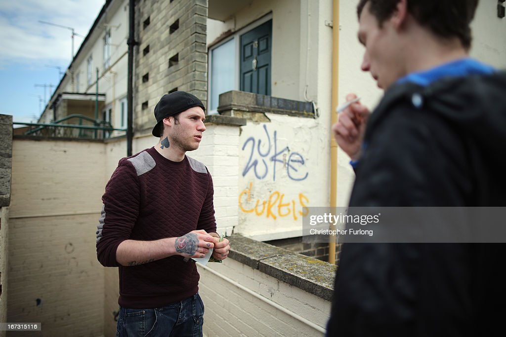 Unemployed brothers Andrew (L) and Jonathan Courtman smoke during the day in Corby Town Centre on April 24, 2013 in Corby, England. A recent study pin pointed Corby as Britain's youth unemployment capital. The study by education specialists Ambitious Minds found that youth unemployment was 11% rising from 4% in 2007. Corby in Northamptonshire was built around its steel industry in the 1930's. The steel works closed in 1980 with the loss of 10,000 jobs.