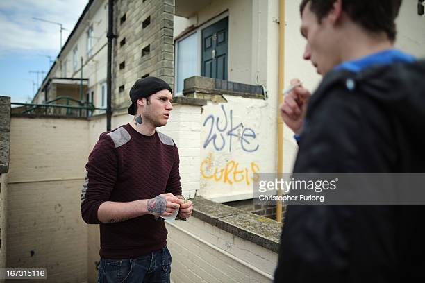 Unemployed brothers Andrew and Jonathan Courtman smoke during the day in Corby Town Centre on April 24 2013 in Corby England A recent study pin...