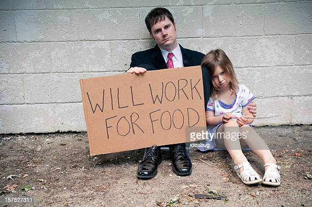 Unemployed Businessman and Daughter Holding Will Work For Food Sign