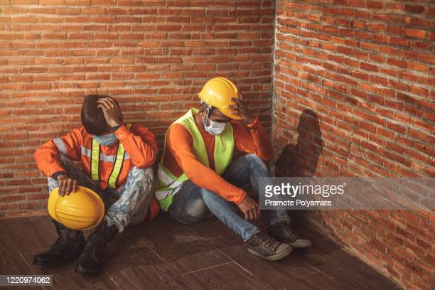 [unemployed construction workers] construction company shutdown due to outbreak of coronavirus disease 2019 or covid-19. concept of economic crisis, labor unemployment and construction workers. - being fired photos stock pictures, royalty-free photos & images