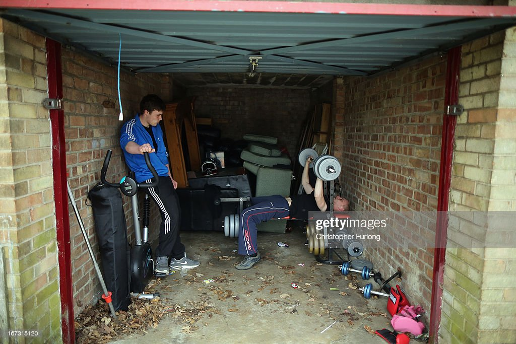 Unemployed friends James King (L), 17, and Darren Madden, 24, workout in their makeshift gym inside a lock up garage on April 24, 2013 in Corby, England. A recent study pin pointed Corby as Britain's youth unemployment capital. The study by education specialists Ambitious Minds found that youth unemployment was 11% rising from 4% in 2007. Corby in Northamptonshire was built around its steel industry in the 1930's. The steel works closed in 1980 with the loss of 10,000 jobs.