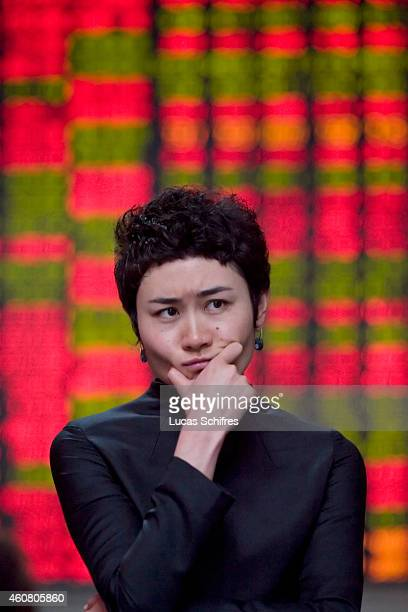 Unemployed Han Mei looks concerned as she stands in a small brokerage house on February 04 2009 in Shanghai China Han Mei worked in Investment...