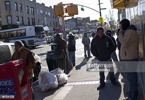Unemployed hispanic construction workers gather on a street corner January 6 2010 waiting to be hired in Bay Ridge New York The nationwide...