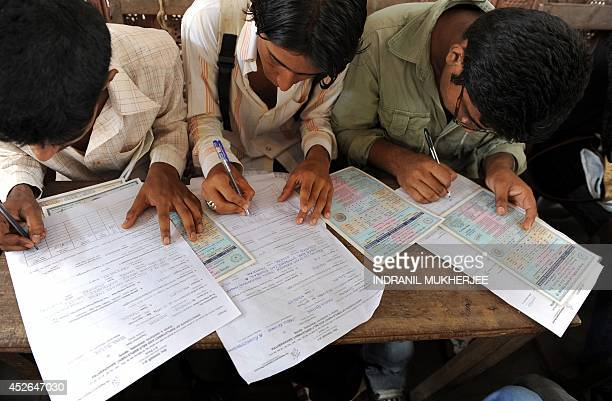 Unemployed Indian youth fill in registration forms at an employment bureau in Mumbai on June 17 2009 Indian companies have shown keeness to hire more...