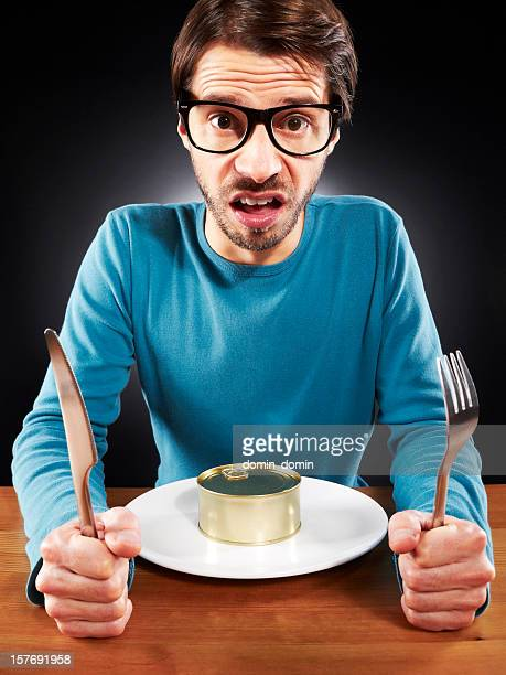 Unemployed man have to tighten the belt, eating canned food