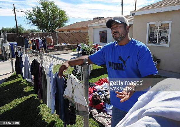 Unemployed man Rafael sells clothing from is house in the southern Californian town of El Centro a town of 50000 people where 304 percent of the...