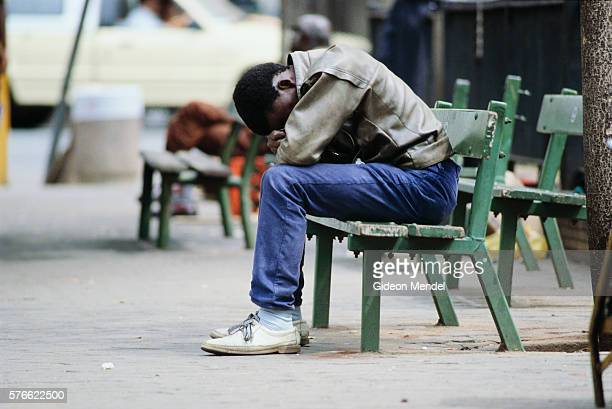 Unemployed Man Sitting on Bench