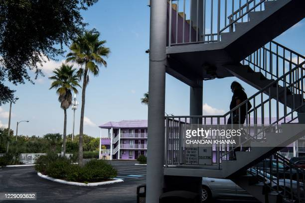 Unemployed man walks down from the staircase at The Magic Castle Inn in Kissimmee, Florida on October 15, 2020. - Labor Department data showed new...