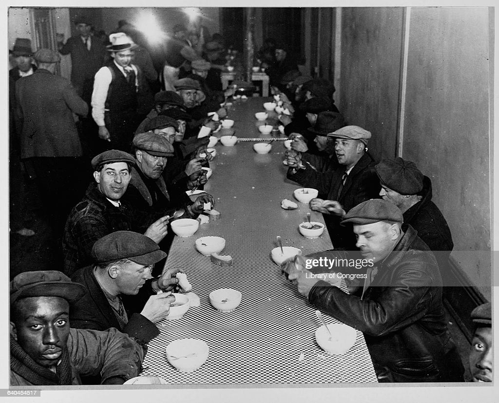 Unemployed Men Enjoy A Meal At A Soup Kitchen Financed By Al Capone On  State Street