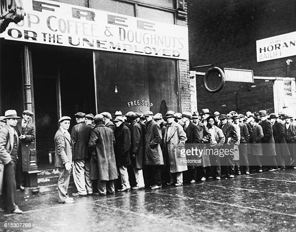 Unemployed men line up outside a Great Depressionera soup kitchen opened in Chicago by Al Capone The storefront sign reads Free Soup Coffee and...