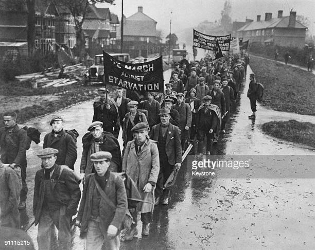 Unemployed men on a hunger march pass through a British town circa 1935