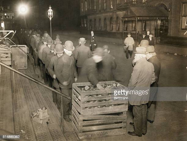 Unemployed men on bread line during the Depression. B/W photograph, undated.