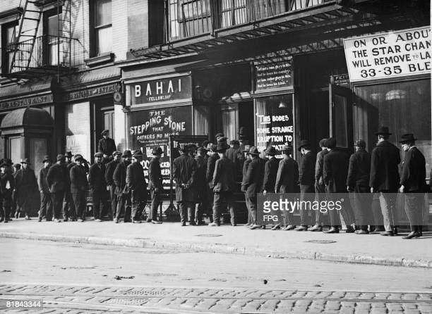 Unemployed men queuing for coffee and bread at a soup kitchen run by the Bahai Fellowship at 203 East 9th Street New York circa 1930