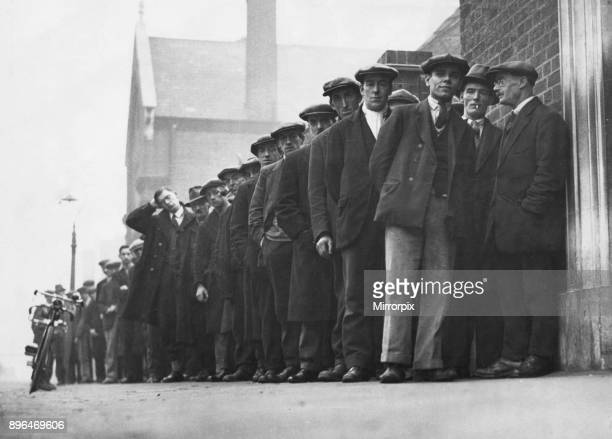 Unemployed men seen here queueing up at the Labour Exchange in the Midlands 23rd October 1931